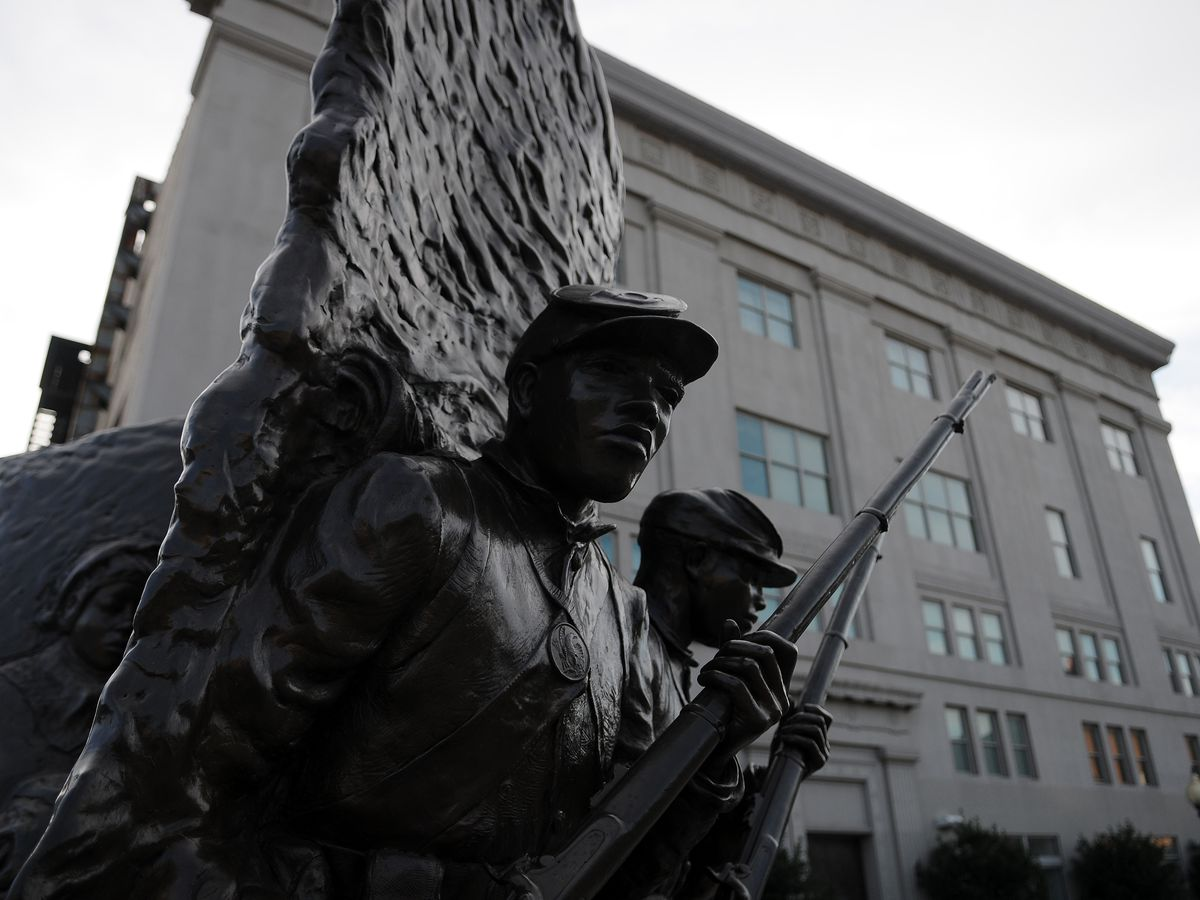 A sculpture at the African American Civil War Museum. The sculpture depicts soldiers with guns.