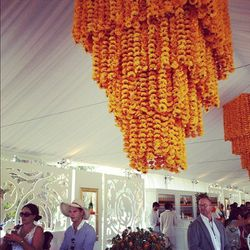 An intricate floral fixture in Veuve Clicquot's signature yellow hue