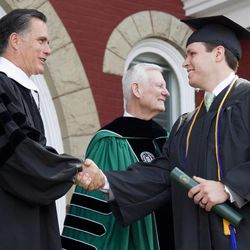 Mitt Romney congratulates a member of the class of 2013 at Southern Virginia University on April 27, 2013.