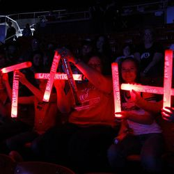 The Riding family from Delta Utah makes a Utah sign out of glow wands during the NCAA Salt Lake Regional Gymnastics Saturday, April 7, 2012 in Salt Lake City.