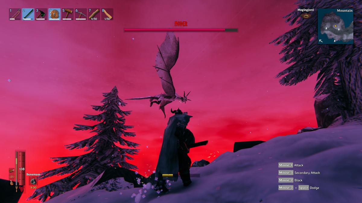 A Valheim player looking up a Moder as she flies around a mountain