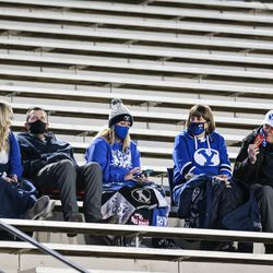 Brigham Young Cougars fans sits in the stand with their masks on during an NCAA football game at LaVell Edwards Stadium in Provo on Saturday, Oct. 31, 2020.
