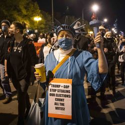 Lora Chamberlain, 65, of Edgewater, president of Clean Count Cook County, joins at least 1,000 protesters to march through the Loop, demanding every vote be counted in the general election, Wednesday night, Nov. 4, 2020.