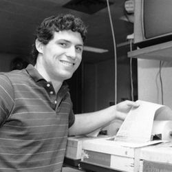 Steve Young, BYU's quarterback who was picked for the Associated Press All-American team, holds wire copy during his visit to the Associated Press office in New York, Dec. 5, 1983.