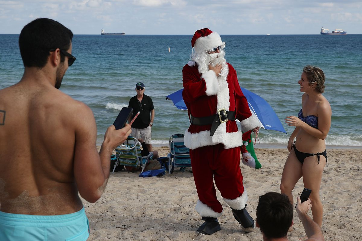 Santa Brings Holiday Spirit To Beach In Fort Lauderdale, Florida