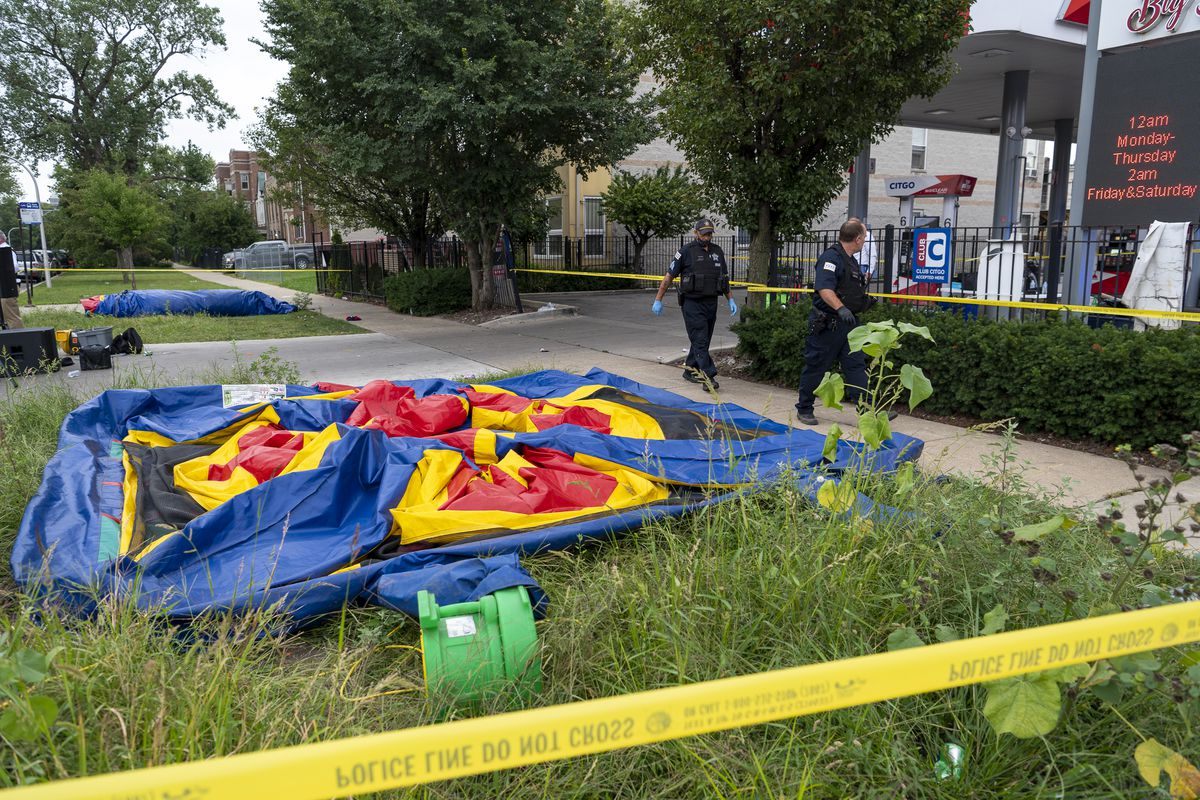 Chicago police work the scene where 3 people were wounded in a shooting, including a 11-year-old boy and a 14-year-old girl, outside a Citgo gas station at N. Sacramento Blvd and W. Fulton St. in the East Garfield Park neighborhood, Saturday, Sept. 4, 2021. A back to school picnic was happening at the Citgo when the shooting occurred.