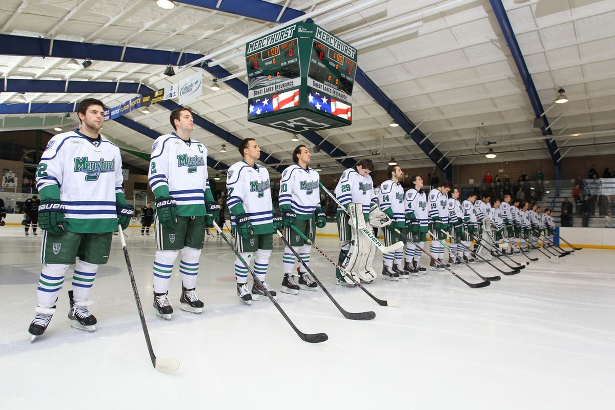 Mercyhurst players stand for the national anthem.