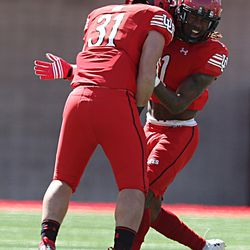 Utah's Tre' Strong (31) and Boobie Hobbs celebrate during the annual Red & White Spring Game at Rice-Eccles Stadium in Salt Lake City on Saturday, April 15, 2017.