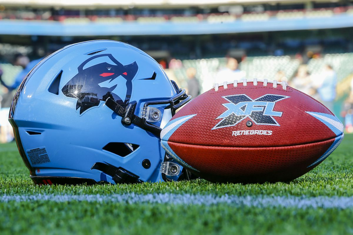 A Dallas Renegades football and helmet lays in the grass during the open practice for the XFL Dallas Renegades on February 1, 2020 at Globe Life Park in Arlington, Texas.