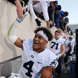 BYU Cougars linebacker Fred Warner (4) high-fives fans in East Lansing, Mich., on Saturday, Oct. 8, 2016. BYU won 31-14.