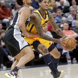 Utah Jazz guard Jordan Clarkson (00) moves around San Antonio Spurs guard Bryn Forbes (11) during an NBA game at Vivint Arena in Salt Lake City on Friday, Feb. 21, 2020. The Jazz lost 104-113.