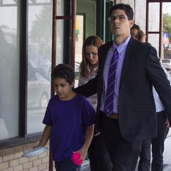 Lidia Souza, her nine-year-old son Diogo and their attorneys walk out of the office of Heartland Alliance in Chicago.| Pat Nabong/For the Sun-Times