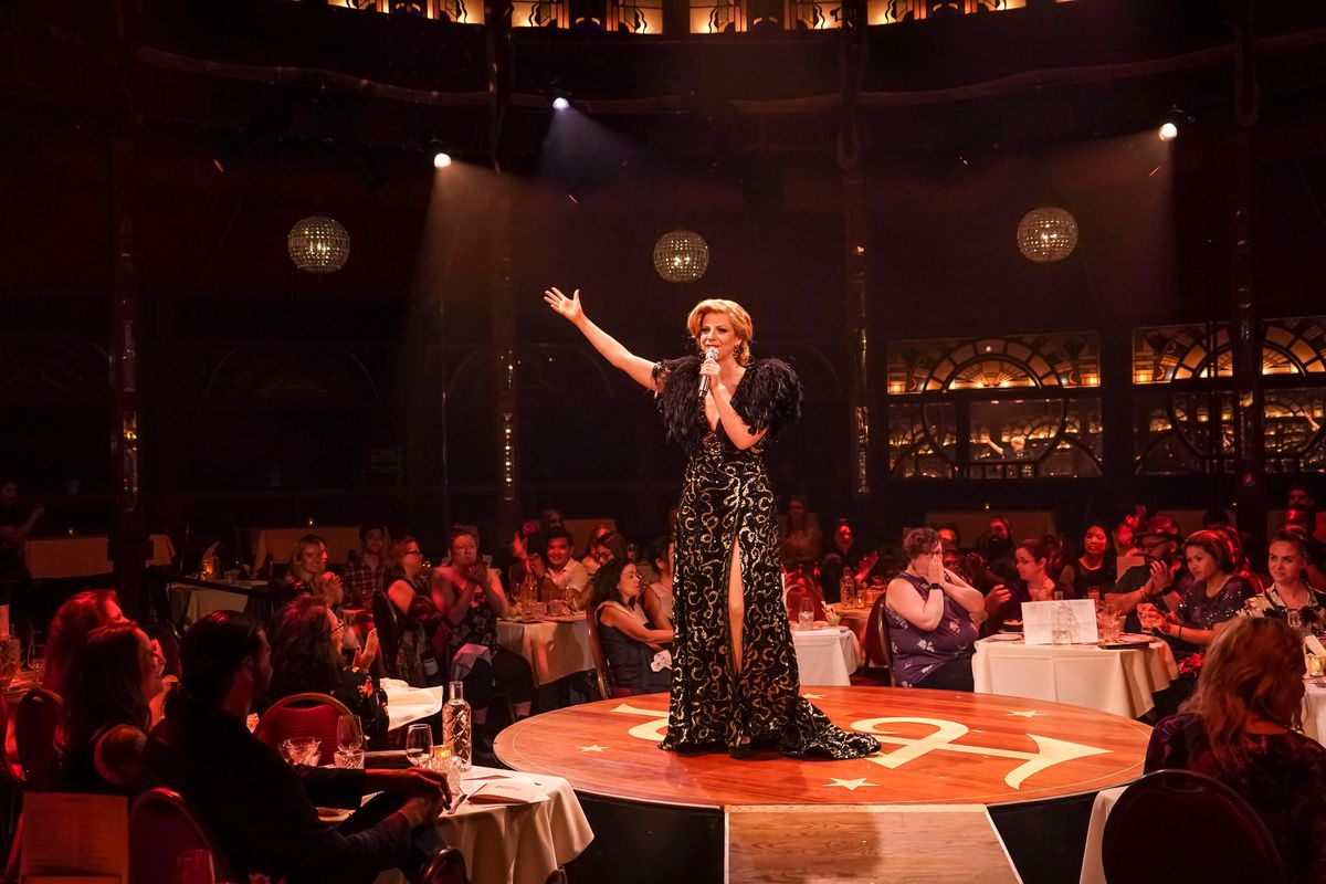 """Rizo (Amelia Zurin-Brown) entertains patrons with her powerhouse vocals in Teatro ZinZanni's """"Love, Chaos & Dinner."""""""