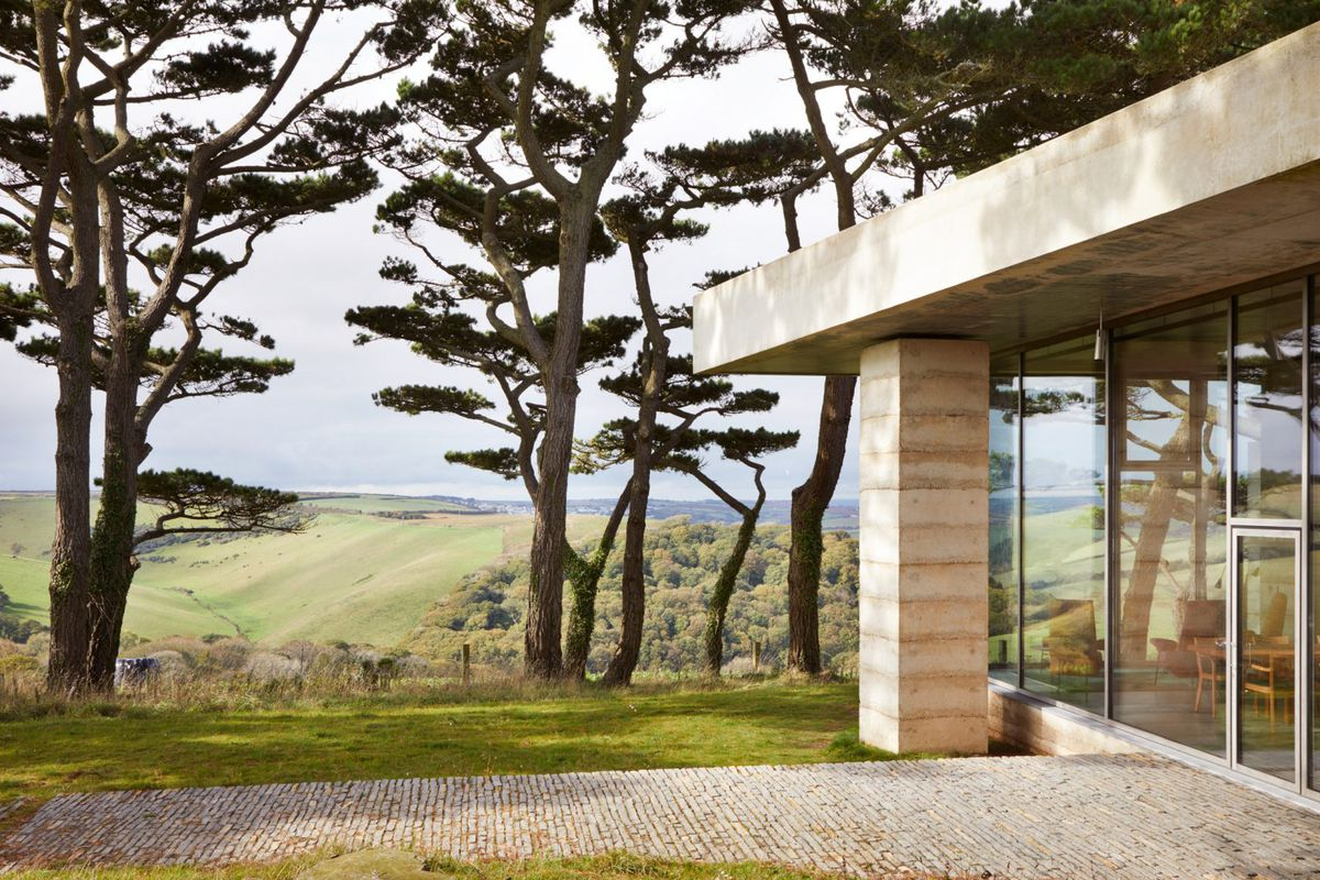 Concrete and glass building on hill
