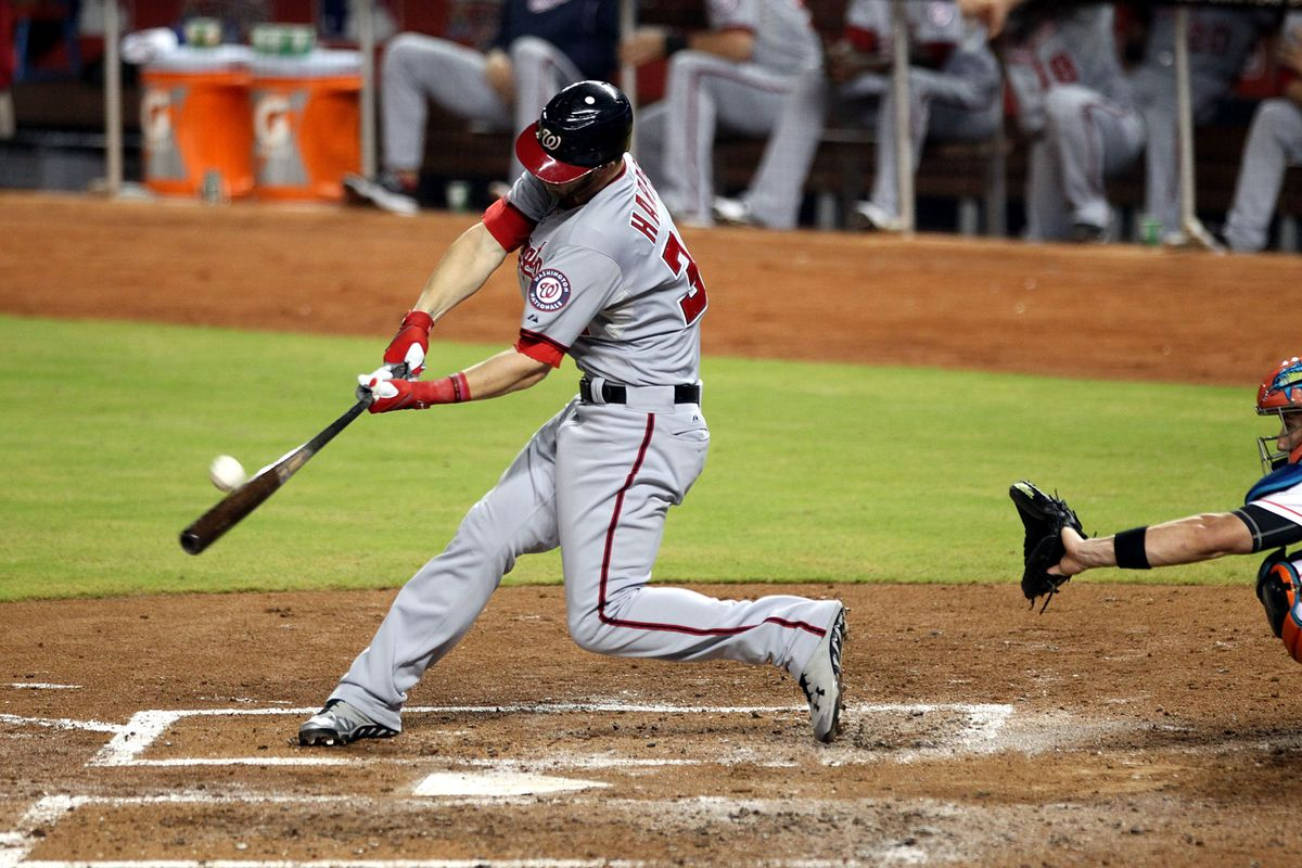 MIAMI, FL - AUGUST 29:  Bryce Harper #34 of the Washington Nationals hits a home run against the Miami Marlins at Marlins Park on August 29, 2012 in Miami, Florida.  (Photo by Marc Serota/Getty Images)