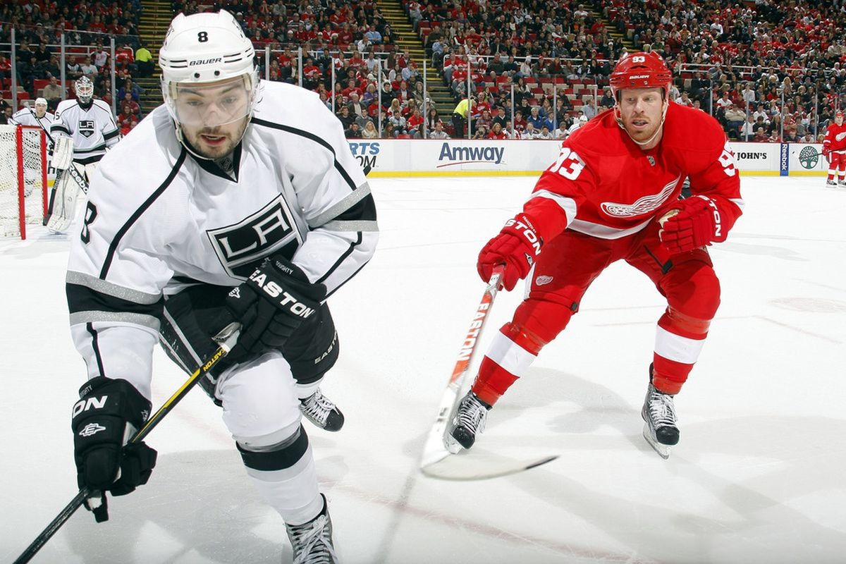 DETROIT, MI - DECEMBER 17:  Johan Franzen #93 of the Detroit Red Wings defends against Drew Doughty #8 of the Los Angeles Kings during their NHL game at Joe Louis Arena on December 17, 2011 in Detroit, Michigan.  (Photo by Dave Sandford Getty Images)