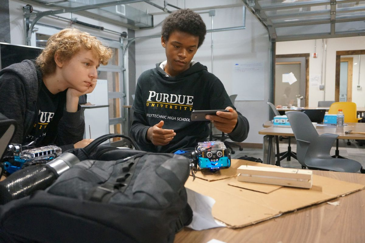 Phoenix Clark, right, is a freshman at Purdue Polytechnic High School. During his first project his team designed a filter to help clean the White River.