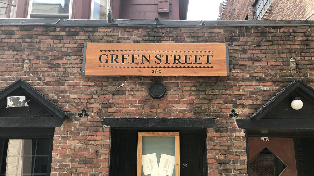 green street cambridge - A historic facade, complete with mysteriously embedded bottles of Angostura Bitters