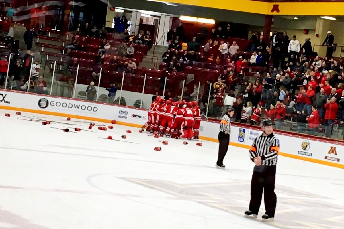 Badgers hugging after winning the 2019 WCHA Final Faceoff championship.
