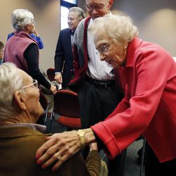 Aileen Clyde greets Boyer Jarvis as the Utah Citizens' Counsel announces its 2014 Assessment of Utah's Policy Progress in Salt Lake City, Wednesday, Dec. 10, 2014.