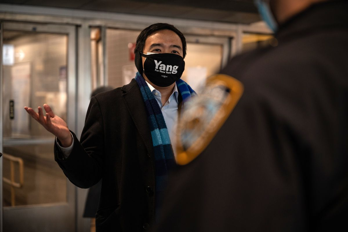 Mayoral candidate Andrew Yang speaks with the NYPD in Staten Island after a disturbed passenger rushed a photojournalist with a metal broom stick on the ferry Friday morning, Feb. 26, 2021.
