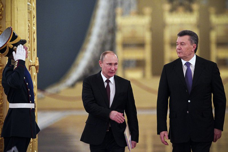 Russian President Vladimir Putin (left) and then President of Ukraine Viktor Yanukovych arrive for a Russian-Ukrainian Summit.