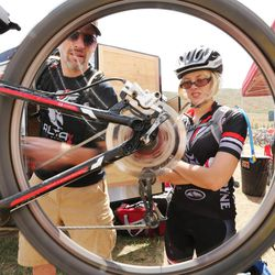 Alta High junior Madeleine Hales has some help with her bike from her dad and coach Steve Hale as she competes for her school bike racing team during a race at Soldier Hollow Saturday, Aug. 29, 2015.