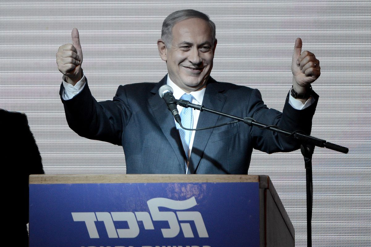 Netanyahu beams to supporters at party election headquarters after the results.