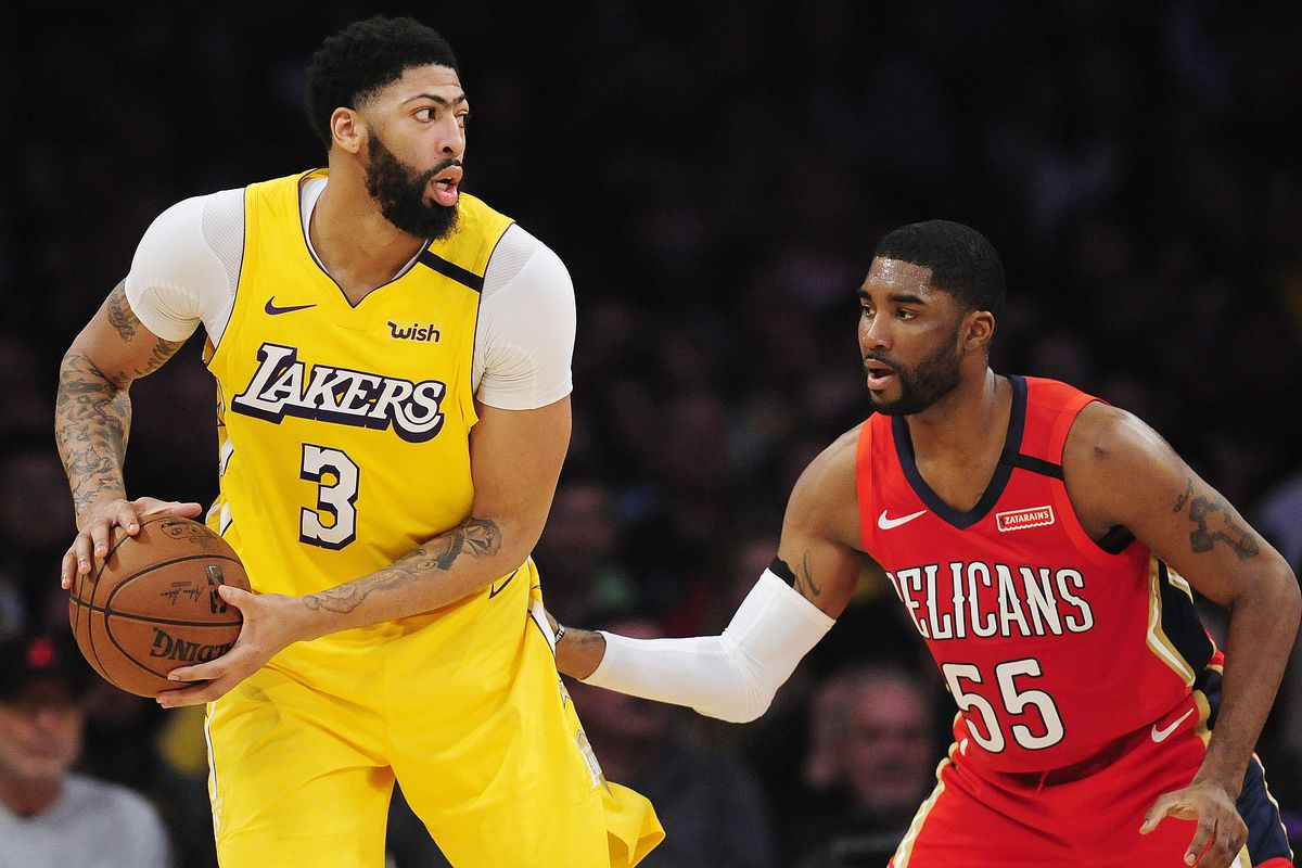 Los Angeles Lakers forward Anthony Davis moves the ball against New Orleans Pelicans guard E'Twaun Moore during the first half at Staples Center.