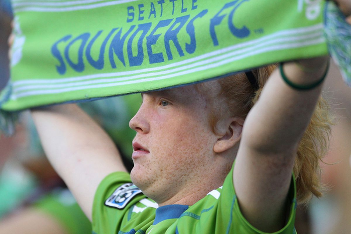 SEATTLE - JULY 25:  A fan of the Seattle Sounders FC holds a sign  during the game against the Colorado Rapids on July 25 2010 at Qwest Field in Seattle Washington. The Sounders defeated the Rapids 2-1. (Photo by Otto Greule Jr/Getty Images)