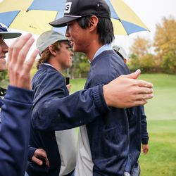 Skyline's Peter Kim, right, is congratulated by teammates after finishing his second round, giving Skyline the team title at the 5A boys state golf tournament at The Oaks at Spanish Fork in Spanish Fork on Tuesday, Oct. 5, 2021.