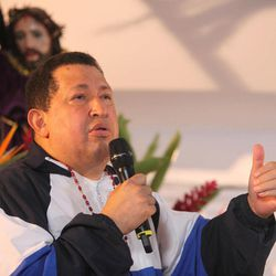 In this photo released by Miraflores Press Office, Venezuela's President Hugo Chavez delivers a speech as he attends a mass in Barinas, Venezuela, Thursday, April 5, 2012. Chavez, who attended the mass accompanied by relatives Thursday after returning from his latest round of radiation therapy treatment in Cuba, vowed to overcome cancer and to run for re-election in October.