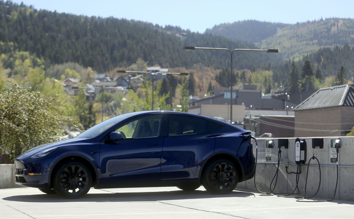 A Tesla is plugged into a charging outlet in the South Marsac lot next to City Hall in Park City on Tuesday, Sept. 29, 2020.