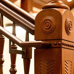 A wooden staircase inside the Provo City Center Temple.