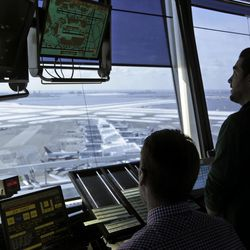 In this March 16, 2017 photo, air traffic controllers work in the tower at John F. Kennedy International Airport in New York. President Donald Trump is looking to shift responsibility for the system from the government to a private, nonprofit corporation run by airlines and other aviation interests.