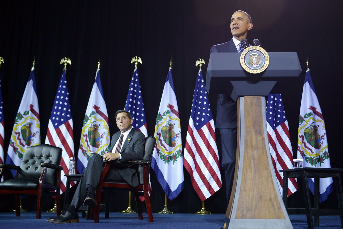 President Barack Obama speaks about the opioid painkiller and heroin epidemic, with National Drug Control Policy Director Michael Botticelli sitting at his side.