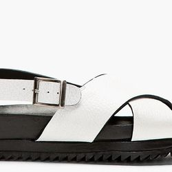 """<b>Surface to Air</b> Crestina sandal, <a href=""""http://www.ssense.com/women/product/surface_to_air/black_and_white_grained_leather_crestina_sandals/94772"""">$340</a>"""