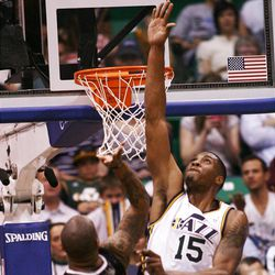 Utah Jazz forward Derrick Favors (15) goes high trying to get at the shot of Orlando's #14 Jameer Nelson as the Utah Jazz and the Orlando Magic play Saturday, April 21, 2012 in Energy Solutions arena.