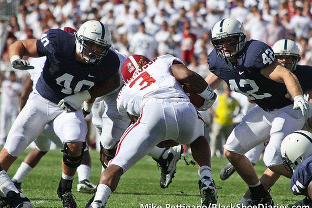 """Glenn Carson (40) and Michael Mauti (42) tackles Alabama's Trent Richardson. (Photo: <a href=""""http://www.flickr.com/photos/mikepettigano/6140433970/in/photostream/"""">Mike Pettigano / BSD</a>)"""