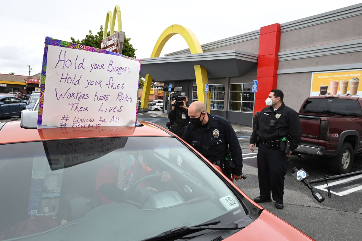 McDonald's employees and supporters protest outside a McDonald's in Los Angeles on Monday, demanding pay for quarantine time and health care for workers who get sick from the coronavirus.
