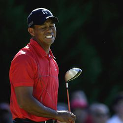 Tiger Woods reacts after teeing off on the 17th hole during the final round of the Tour Championship golf tournament on Sunday, Sept. 23, 2012, in Atlanta.