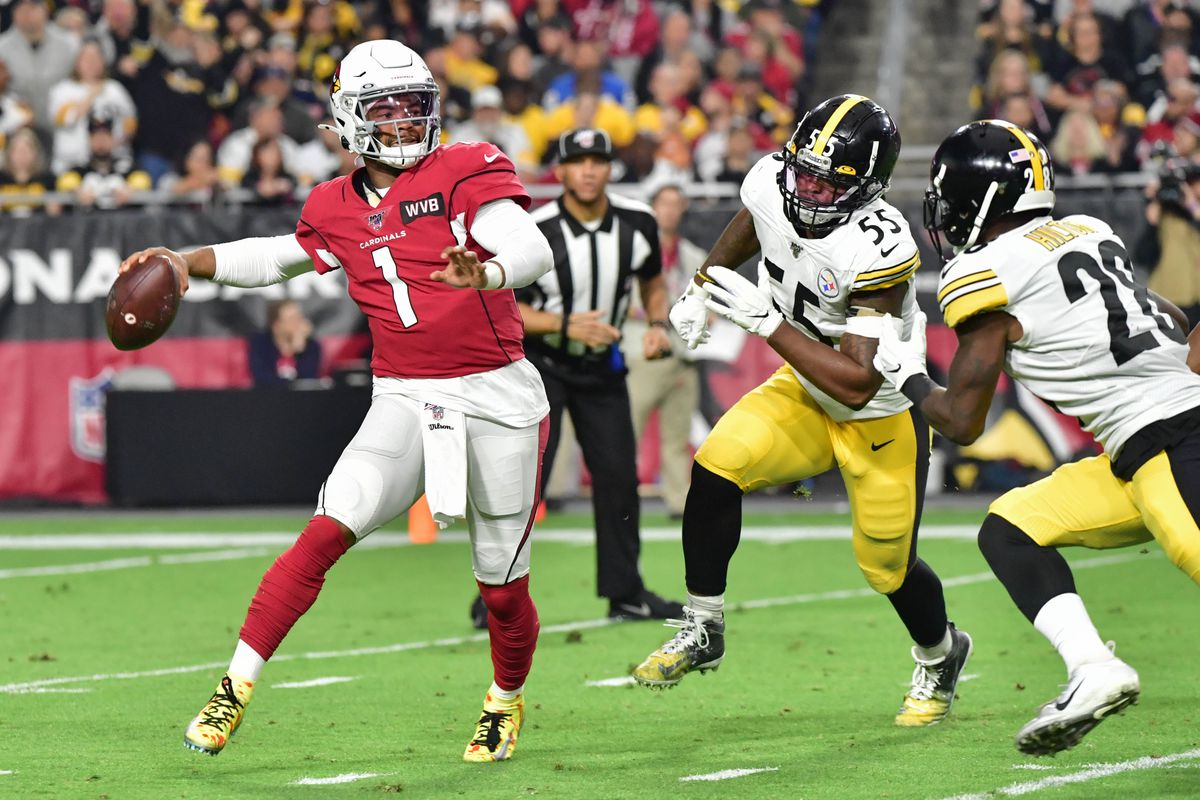 Arizona Cardinals quarterback Kyler Murray throws the ball under pressure from Pittsburgh Steelers linebacker Devin Bush and cornerback Mike Hilton during the first half at State Farm Stadium.