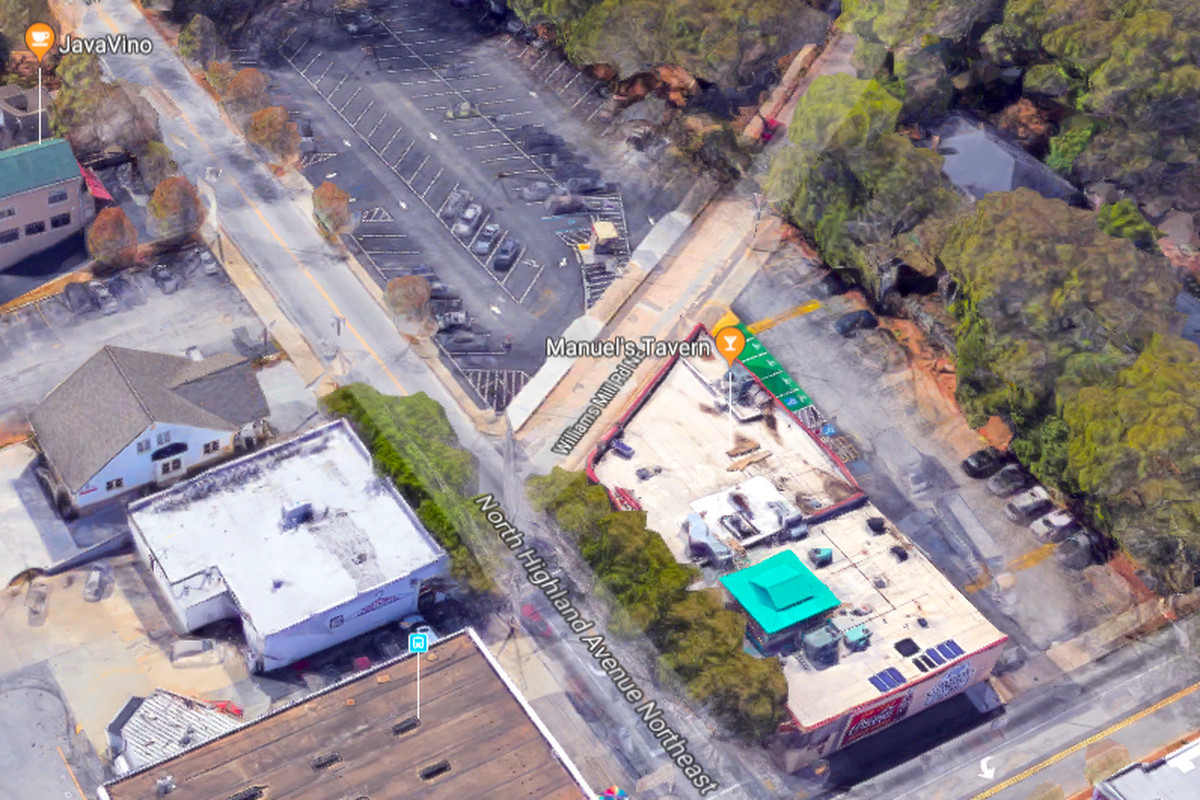 At top is the formerly free parking lot where Selig Enterprises has fenced off a construction site.