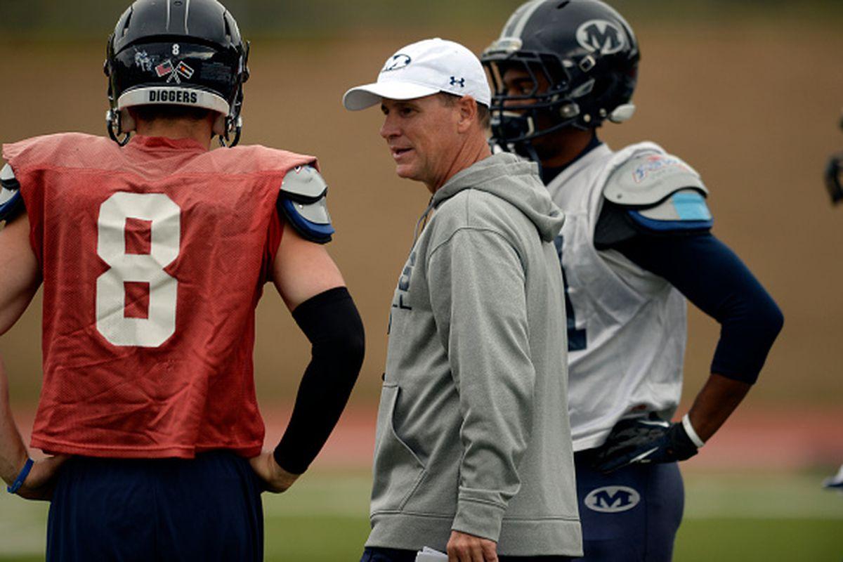 Bob Stitt talks with quarterback Justin Dvorak during practice September 30, 2014.