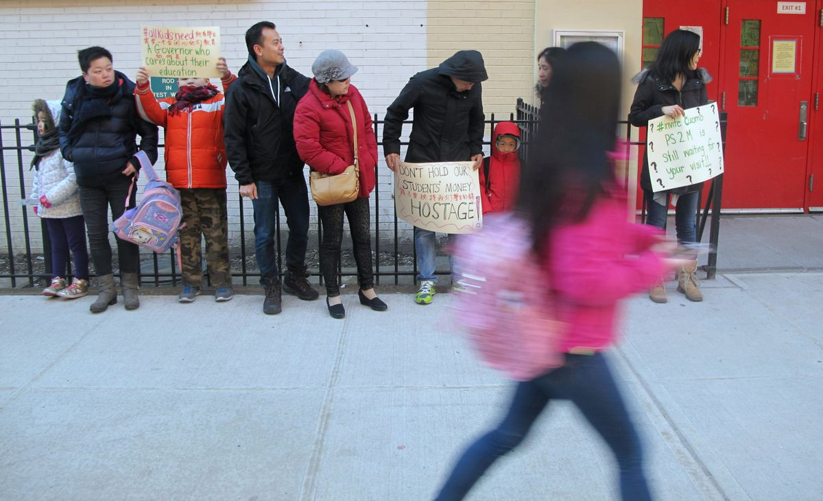 P.S. 2 parents and students lined up along the metal fence outside the school Thursday morning.