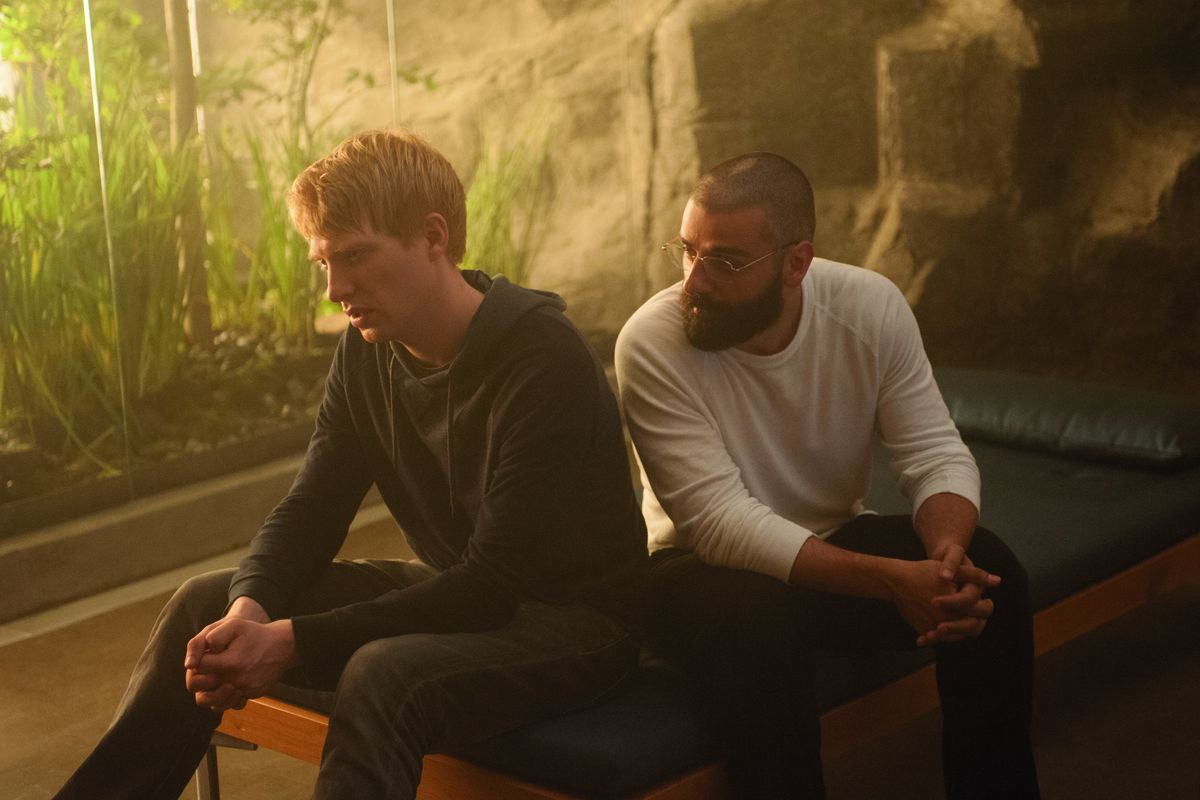 Domnhall Gleeson and Oscar Isaac play two men in extreme seclusion, working to test the intelligence of a robot, in Ex Machina.