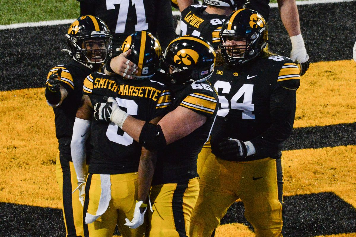 Iowa Hawkeyes wide receiver Ihmir Smith-Marsette (6) reacts with offensive lineman Tyler Linderbaum (65) and offensive lineman Kyler Schott (64) after scoring a touchdown during the third quarter against the Wisconsin Badgers at Kinnick Stadium. Mandatory Credit: Jeffrey Becker