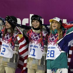 From left, bronze medalist United States' Kelly Clark, gold medalist United States' Kaitlyn Farrington and silver medalist Australia's Torah Bright pose following the women's snowboard halfpipe at the Rosa Khutor Extreme Park at the 2014 Winter Olympics, Wednesday, Feb. 12, 2014, in Krasnaya Polyana, Russia. (AP Photo/Felipe Dana)