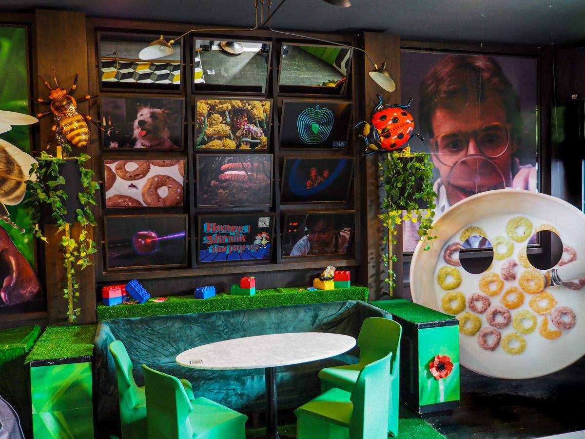 """A bar with tons of pop culture photos from """"Honey, I Shrunk the Kids."""""""