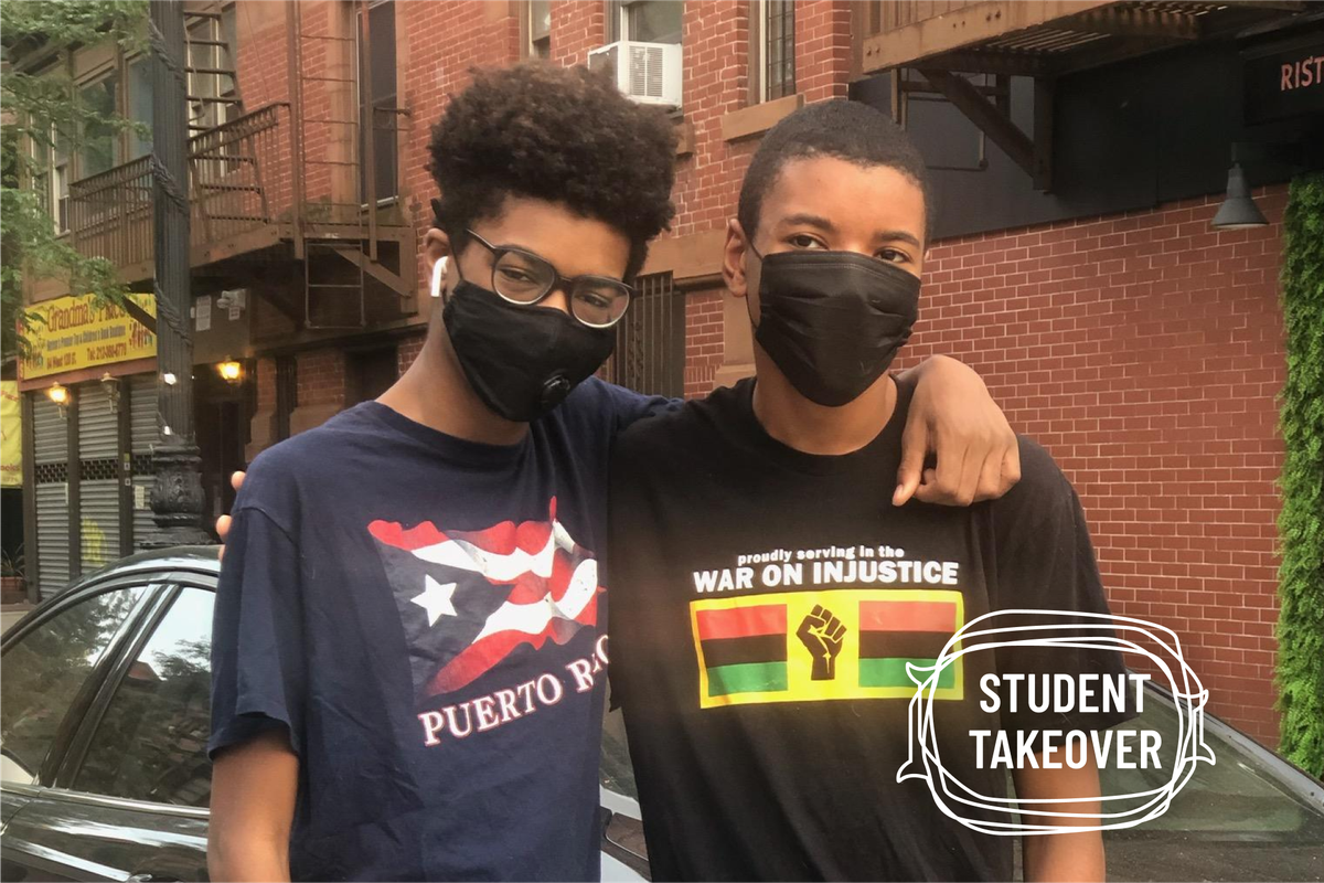 Brothers, Hudson and Hunter Russell-Horton standing side by side wearing black facemasks. Hunter has his arm around his brother Hudson.